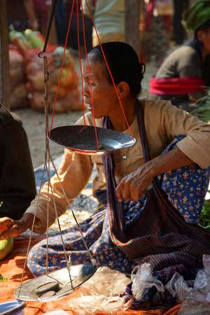 weekly market: INLE LAKE, MYANMAR - MAR 1, 2015 - Woman selling rice noodles at the weekly market on   Inle Lake,  Myanmar (Burma) Editorial