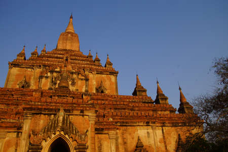 archtecture: Elaborate carvings and ceramic decorations on exterior of Htilominlo Temple, Bagan,  Myanmar (Burma) Stock Photo