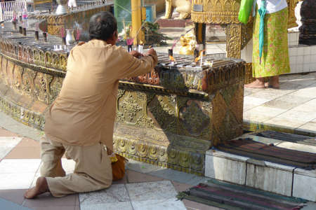 planetary: Offering of holy water at planetary post, name day, shrine, Shwedagon Pagoda Yangon (Rangoon),  Myanmar (Burma)