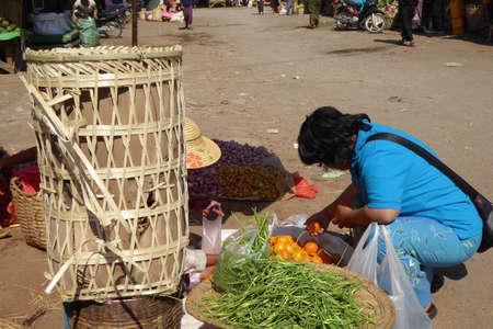 AUNG BAN, BURMA - FEB 28, 2015 - Buying fruit at the weekly market in  Aung Ban,  Myanmar (Burma)