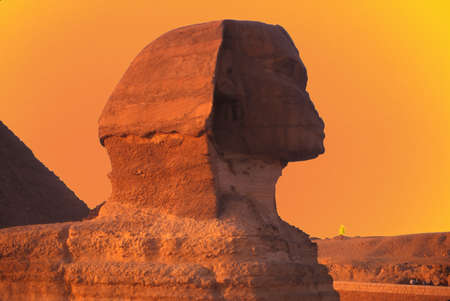 egyptology: Sphinx at sunset, with pyramids in background, , Giza, Egypt, Middle East