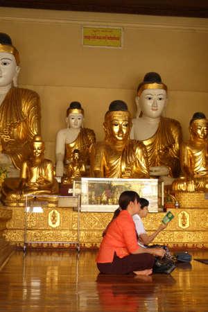 YANGON, BURMA - FEB 18, 2015 - Visitors at Buddhist temple in Shwedagon Pagoda Yangon (Rangoon),  Myanmar (Burma) Editoriali