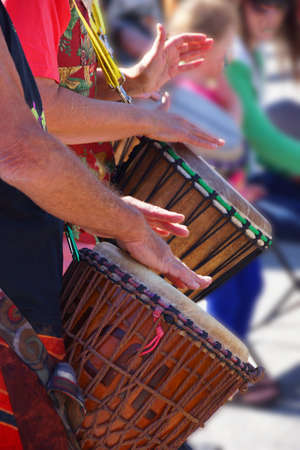 playing the market: Drummers playing at a Saturday market,  Penticton, British Columbia, Canada..