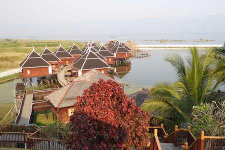 inle: INLE LAKE, MYANMAR - MAR 1, 2015 - Sunrise over the floating cottages, Hupin Hotel on  Inle Lake,  Myanmar (Burma)