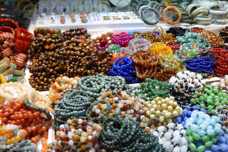 central market: Beads, bangles and necklaces for sale   in the central market of  Yangon (Rangoon),  Myanmar (Burma) Stock Photo