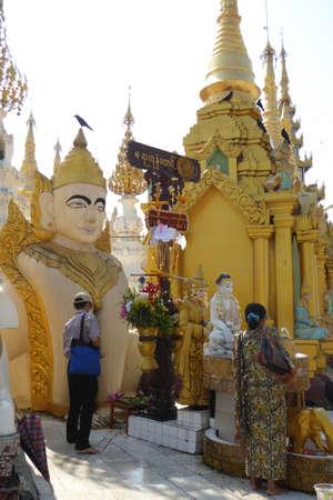 YANGON, MYANMAR - FEB 18, 2015 - Pagodas and Planetary stations on the platfiorm of Shwedagon Pagoda in Yangon,  Myanmar (Burma)