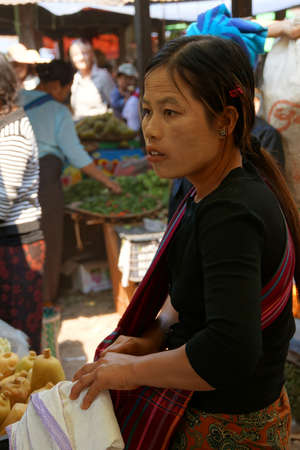 weekly market: INLE LAKE, MYANMAR - MAR 1, 2015 - Young woman at the weekly market on  Inle Lake,  Myanmar (Burma)