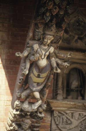 strut: KATHMANDU, NEPAL - OCT 14, 1987 -  Six armed goddess carved on temple strut, Kathmandu, Nepal, Asia