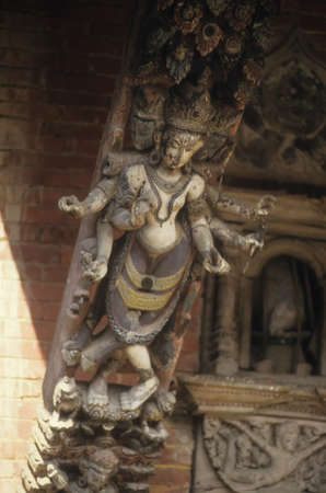 KATHMANDU, NEPAL - OCT 14, 1987 -  Six armed goddess carved on temple strut, Kathmandu, Nepal, Asia