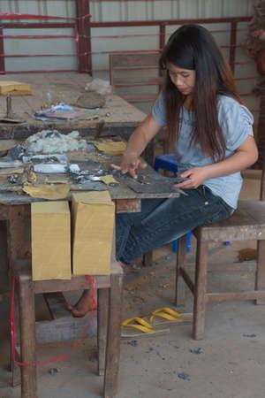 lye: KYAUKME, MYANMAR - FEB 21, 2015 - Combining silver lead foil and bamboo paper, Kyaukme Myanmar (Burma)