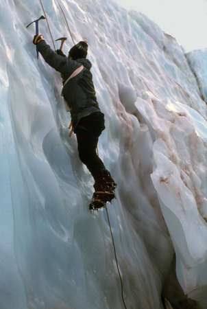 MT RAINIER, WASHINGTON - AUG 1, 1976 - Ice climber ascending crevasse on the Nisqually Glacier in the National Park