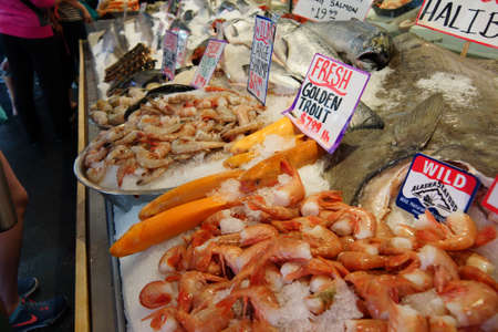 pike place: SEATTLE - JUN 3, 2016 - Golden trout and other seafood on display at the Pike Place Public Market Editorial