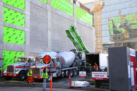 Seattle - FEB 9, 2016 - Cement trucks unloading at construction site  in downtown  Seattle, Washington