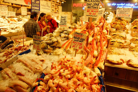 pike place: SEATTLE - JUN 3, 2016 - Fresh crab, lobster and shrimp for sale at the Pike Place Market