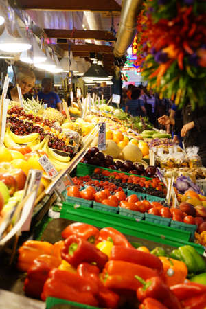 public market: SEATTLE - JUN 3, 2016 - Selling fruit and vegetables  in the high stalls at the Pike Place Public Market , Seattle