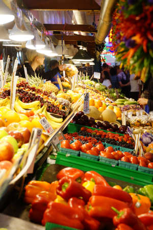 pike place: SEATTLE - JUN 3, 2016 - Selling fruit and vegetables  in the high stalls at the Pike Place Public Market , Seattle