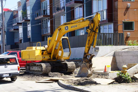 power shovel: SEATTLE - JUN 16, 2016 - Yellow power shovel works on contruction project  in Seattle Editorial