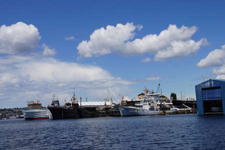 drydock: SEATTLE - JUN 16, 2016 - Working boats and  sailboats at anchor waiting for repairs on  Lake Union, Seattle