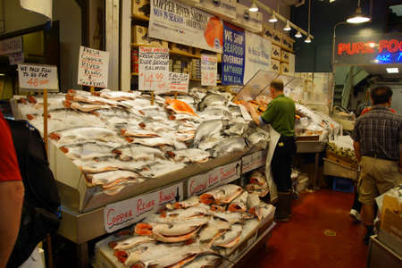 pike place: SEATTLE - JUN 3, 2016 - Fresh salmon for sale  at the Pike Place Public Market , Seattle Editorial