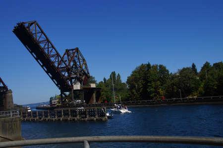 SEATTLE - JUL 24, 2016 - Pleasure boat cruises towards counter weighted railroad bridge, Seattle Editorial