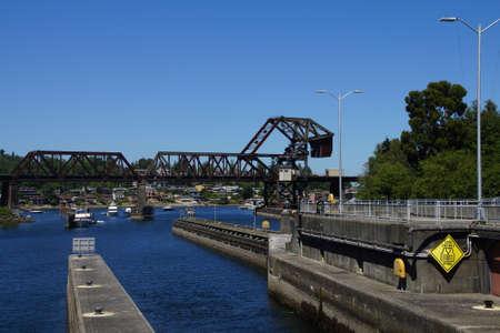SEATTLE - JUL 24, 2016 - Boats wait under railroad bridge to enter  the Hiram Chittenden Locks in Seattle