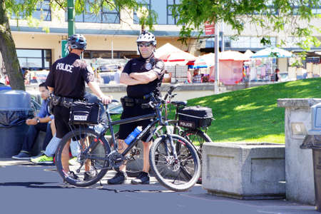 pike place: SEATTLE - JUN 3, 2016 - Seattle bicycle police  at the Pike Place Public Market , Seattle