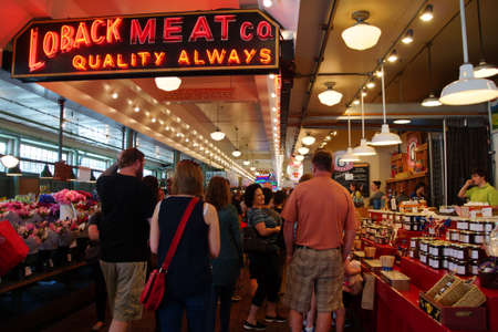 SEATTLE - JUN 3, 2016 - Tourists browse the vendors stalls  at the Pike Place Public Market , Seattle