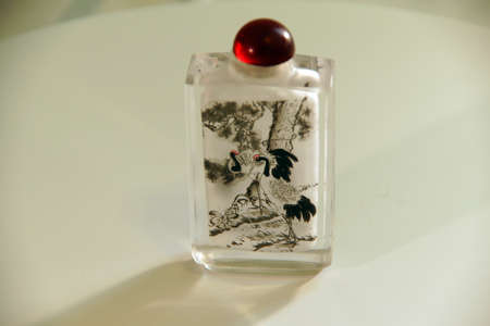 tabaco: SEATTLE - JUL 1, 2016 - Cranes on Chinese crystal snuff bottle, painted from the inside