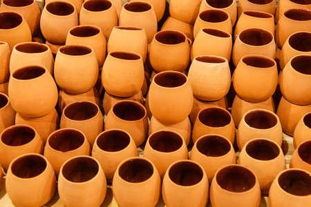 await: Unfired greenware  pots await the kiln,  pottery factory in Avanos, Turkey Stock Photo