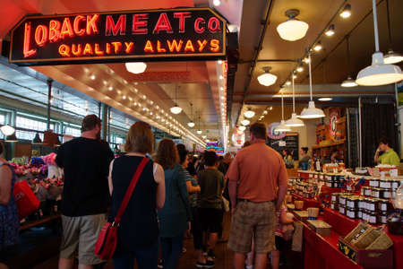 pike place market: SEATTLE - JUN 3, 2016 - Tourists browse the vendors stalls  at the Pike Place Public Market , Seattle