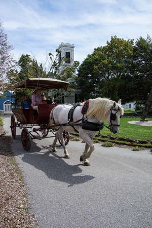 seaports: MYSTIC, CONNECTICUT  - SEP 5, 2013 - Horse and carriage in Old Mystic Seaport, Connecticut.