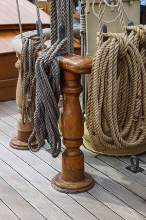 belaying: Ropes and belaying pins on deck of old sailing ship in Old Mystic Seaport, Connecticut.