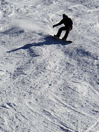 Silhouette of snowboarder on the Tornado piste run Steamboat Springs, Colorado..
