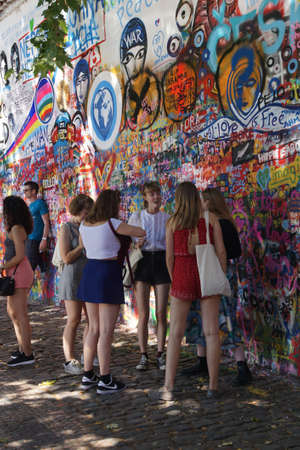 PRAGUE - AUG 31, 2016 - Lennon Wall, symbol of Prague resistance to communism, overlaid graffiti, Prague, Czech Republic
