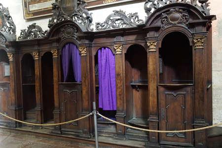 PRAGUE - SEP 1 , 2016 - Confessional with purple curtains, , St Vitus Cathedral,  Prague, Czech Republic