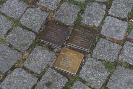 WERTHEIM, GERMANY - SEP 13, 2016 - Holocaust memorial paving stones, outside home of Jewish residents killed in death camps of World War II. Text describes when they were arrested and the camp in which they were murdered Wertheim, Germany Editorial