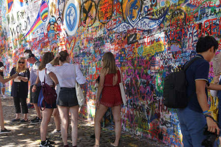 communism: PRAGUE - AUG 31, 2016 - Lennon Wall, symbol of Prague resistance to communism, overlaid graffiti, Prague, Czech Republic