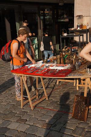 weekly market: NUREMBERG, GERMANY - SEP 10, 2016 - Woman shops for jewelry in the weekly market of  Nuremberg, Germany Editorial