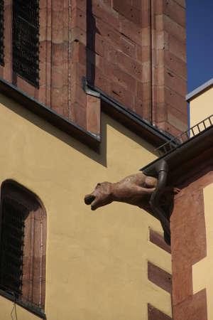 wertheim: Gargoyle on rainspout of medieval house in  Wertheim, Germany Stock Photo