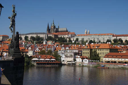 stare mesto: PRAGUE - AUG 31, 2016 - River cruise boat on the Vltava River below Prague castle,Stare Mesto, Old Town of  Prague, Czech Republic