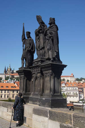 PRAGUE - AUG 31, 2016 - Statue on medieval Charles Bridge  on Vltava River in  Prague, Czech Republic
