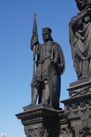 PRAGUE - AUG 31, 2016 - Statue on medieval Charles Bridge  on Vltava River in  Prague, Czech Republic