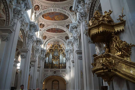 stephen: PASSAU, GERMANY - SEP 8, 2016 - Huge pipe organ and golden pulpit  in  St. Stephens cathedral in  Passau, Germany Editorial