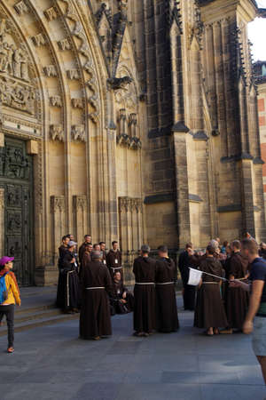 vitus: PRAGUE - SEP 1 , 2016 - Visiting monks gather outside  St Vitus Cathedral,  Prague, Czech Republic
