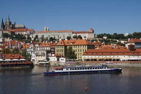 PRAGUE - AUG 31, 2016 - River cruise boat on the Vltava River below Prague castle,Stare Mesto, Old Town of  Prague, Czech Republic