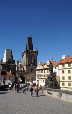 PRAGUE - AUG 31, 2016 - Watchtower at head of Charles Bridge  on Vltava River in  Prague, Czech Republic