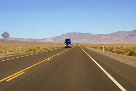 nevada desert: Distant truck is only traffic  on desert highway in Nevada