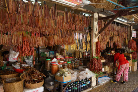 siem: SIEM REAP, CAMBODIA - FEB 16, 2015 - Local sausages on display in market in  Siem Reap,  Cambodia