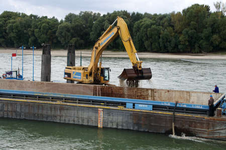 dredging: DANUBE RIVER - SEP 5, 2016 - Dredging tug and barge on the Danube River, Slovakia Editorial