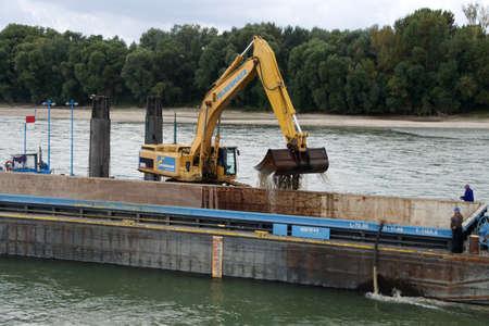 DANUBE RIVER - SEP 5, 2016 - Dredging tug and barge on the Danube River, Slovakia Redakční